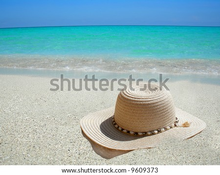 straw hat on the shore of a Caribbean beach