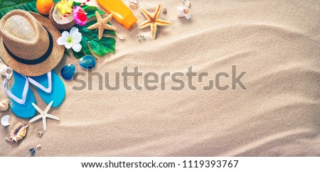 Straw hat with a exotic cocktail and sunglasses on sand beach. Summer Holidays concept #1119393767