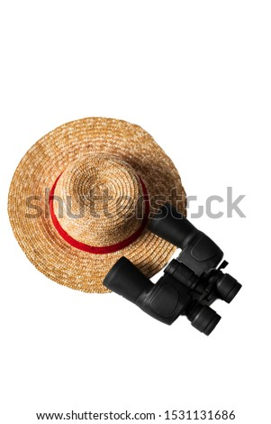 Straw hat with binoculars on isolate white background, Holiday travel concept for birdwatching.