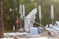 Straw loungers and sun loungers at the water park after a tornado.