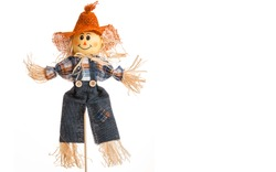 Straw Scarecrow doll in jean denim and Plaid Flannel Shirt. Autumn decorations. Country style. Isolated white background.