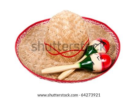straw sombrero and maracas on white background