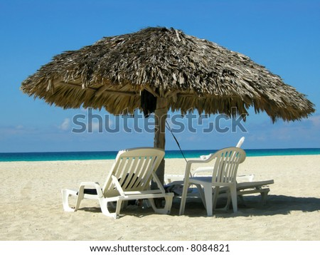 Straw sun shelter and beach chairs at Varadero beach, Cuba
