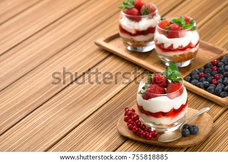 strawberrie dessert, cheesecake, trifle, parfaits on wooden background. copy space. #755818885