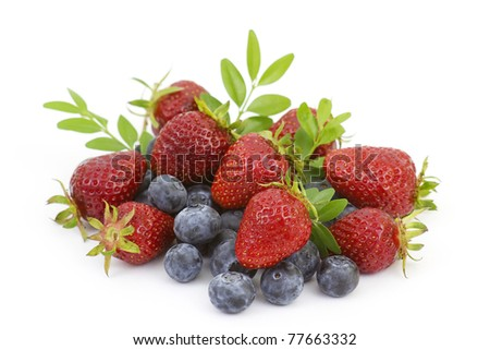Strawberries and blueberries isolated on white