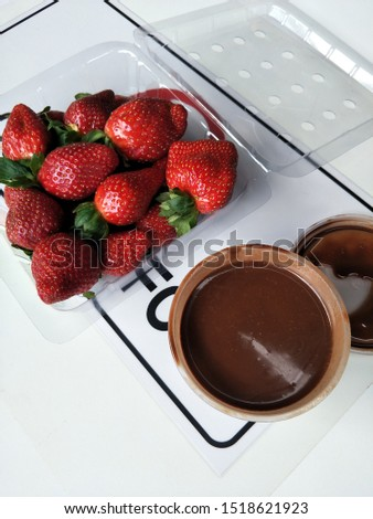 Strawberries and chocolate dip gives  sweet sour taste