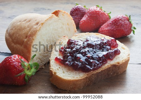 strawberries and strawberry jam on sliced bread