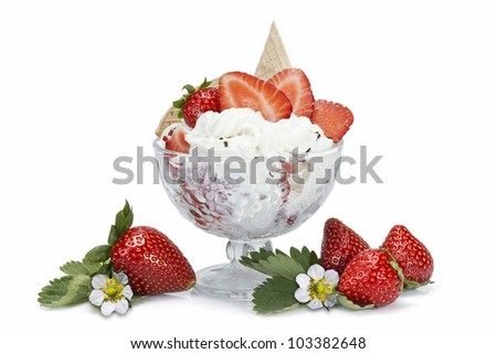 Strawberries and whipped cream cup isolated over a white background.