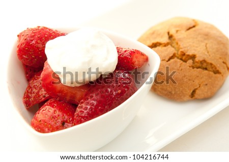 strawberries and whipped cream with a chocolate chip cookie - stock photo