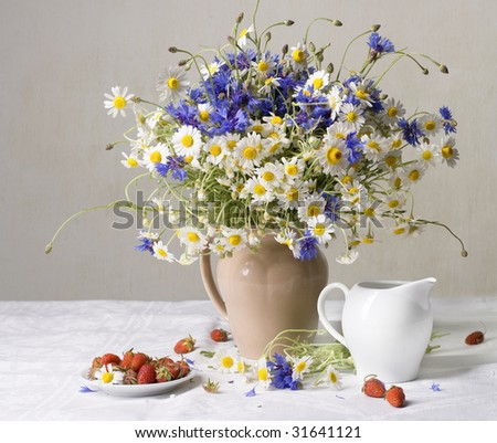 Strawberries and wild flowers - stock photo