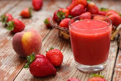 Strawberries, bananas and peaches smoothie. Super delicious and  healthy. Let's try it! Summer vibes, close-up, top view
