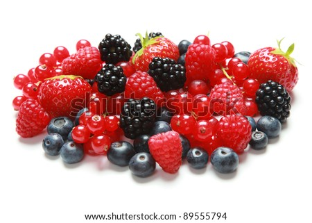 Strawberries, bilberries, red currants, raspberries and blackberries isolated on a white background
