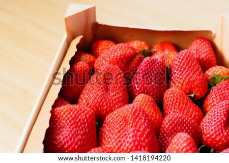 Strawberries freshly harvested in a wooden box, beautiful red and fresh #1418194220