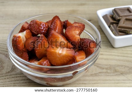 Strawberries in a glass bowl with chocolate. #277750160