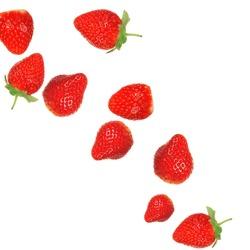 Strawberries in milk splash over white background
