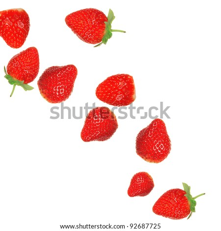 Strawberries in milk splash over white background