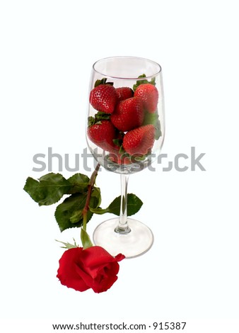 Strawberries in wine glass with rose