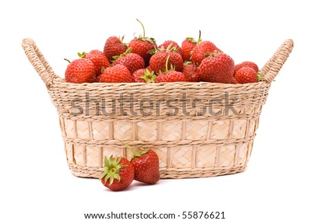 Strawberries in wooden basket isolated on white - stock photo