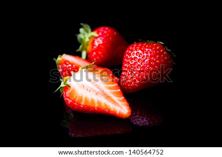 strawberries isolated on black background
