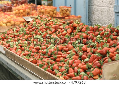 strawberries on display in market