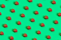 Strawberries pattern on a green background