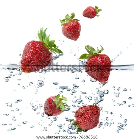 strawberries splash in transparent water, on white background