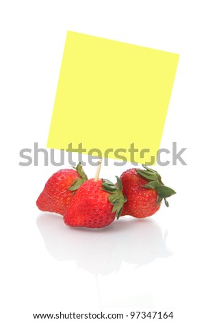 strawberries with blank Note paper isolated on white background