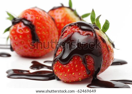 Strawberries with liquid chocolate, isolated on white