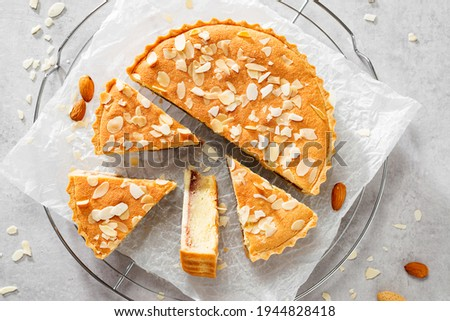 Strawberry Almond Bakewell Tart. Traditional British cuisine. Light gray background,top view.