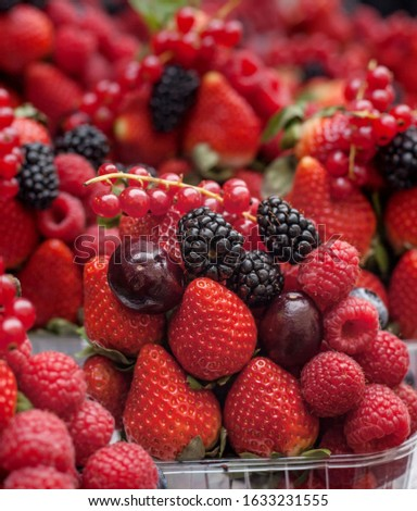 Strawberry and mixed berries at the street market, yummy fresh fruit, Strawberries, Raspberries Blackberries and Blueberries. Healthy Living and Nutritious Food