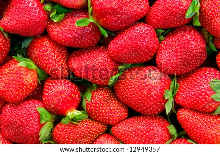Strawberry background - ripe fresh berries. A little oversaturated to express the risk of allergy effect