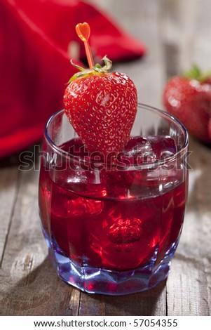 Strawberry Beverage on dark wooden table top