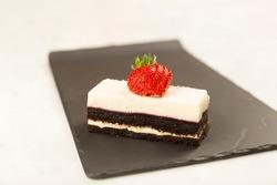 strawberry cake on black marble background