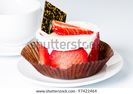 Strawberry cake on cup background close up