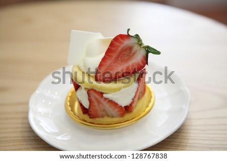 Strawberry Cake on wood