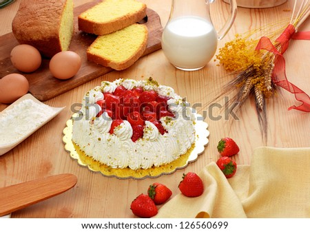Strawberry cake on wooden board
