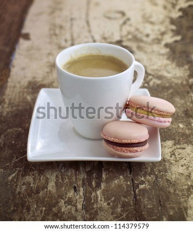 Strawberry & caramel macrons with cup of coffee