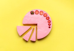 Strawberry cheesecake with three slices on yellow background. Cheese cake with strawberries. Summer dessert flat lay. Homemade no-bake cheesecake.