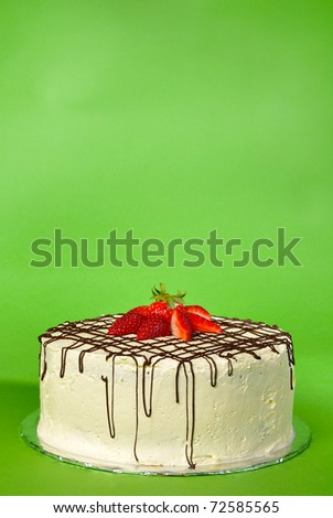 Strawberry chocolate cake on green background with copy space