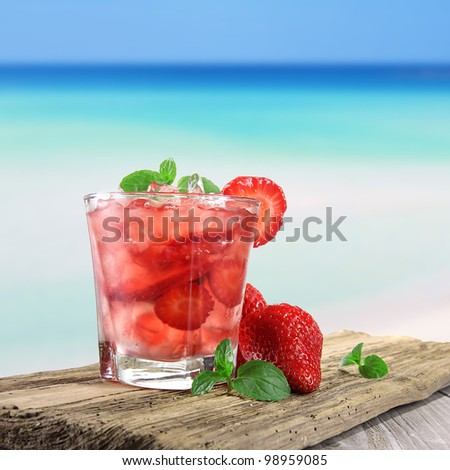 Strawberry cocktail on a beach
