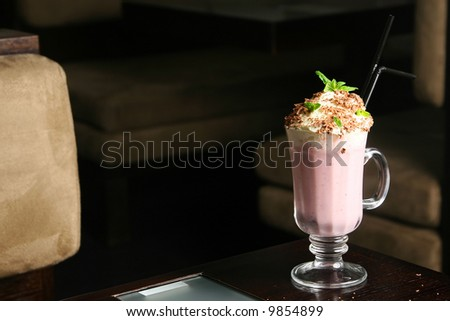 strawberry cocktail on restaurant table dark background