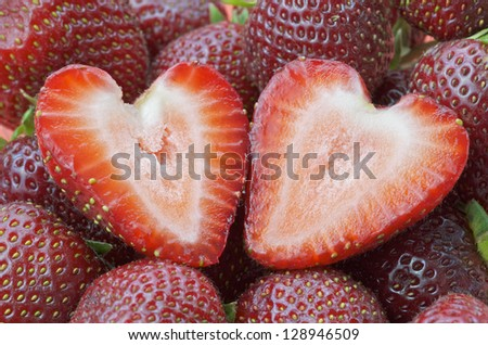 Strawberry Cut In Half On Top Of Other Strawberries
