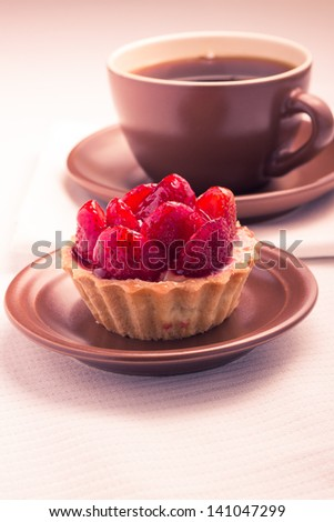 Strawberry dessert in Waffle Basket with Cup of Hot Tea