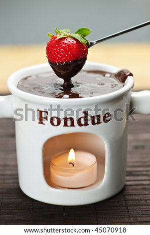 Strawberry dipped in delicious melted chocolate fondue