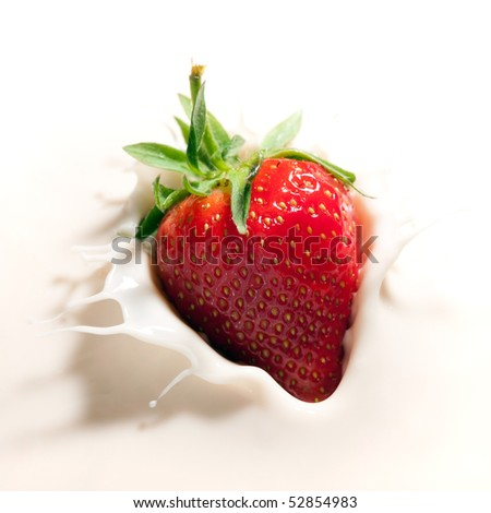 strawberry dropped in yogurt