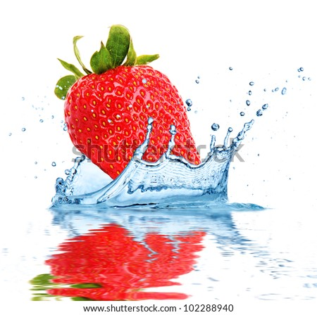 Strawberry falling into water, isolated on white background