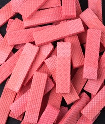 strawberry flavored wafers, crispy, light, thin and flat pink color biscuits, closeup full frame view