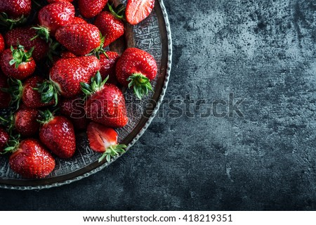Shutterstock Strawberry. Fresh strawberry. Red strewberry. Strawberry Juice. Loosely laid strawberries in different positions.