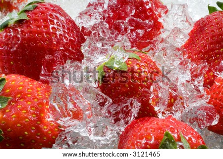 Strawberry frozen in ice