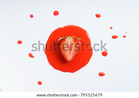 strawberry fruit abstract in red watercolor on white background. freeform shape around sliced object. top view. #795525679